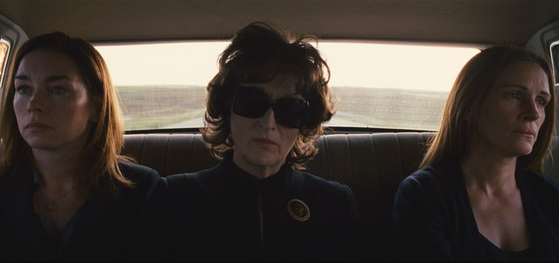 the three stars of August Osage County looking despondent in a car