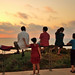 Small photo of Friday evening, a family is watching the sunset