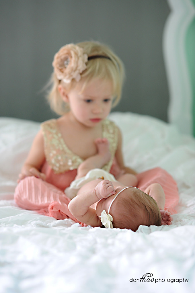 Big sister meets new little sister photography