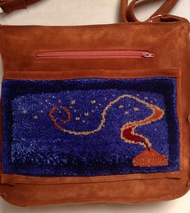 leather and silk pile bag