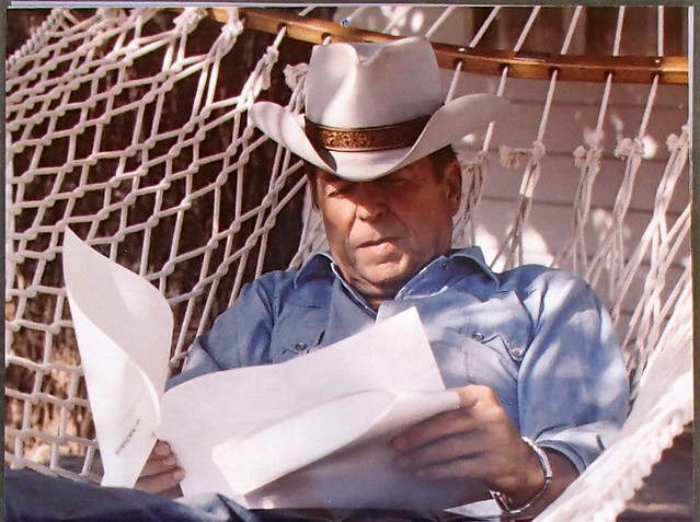 Ronald Reagan reading junk mail