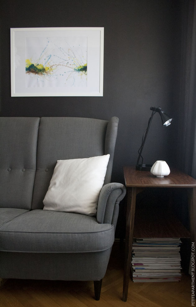 dark grey black living room with grey ikea strandmon sofa mid century