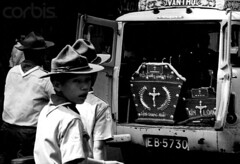 Saigon 1968 - Boy Scouts follow a truck bearing the coffin of a scout killed in action during the Vietnam War