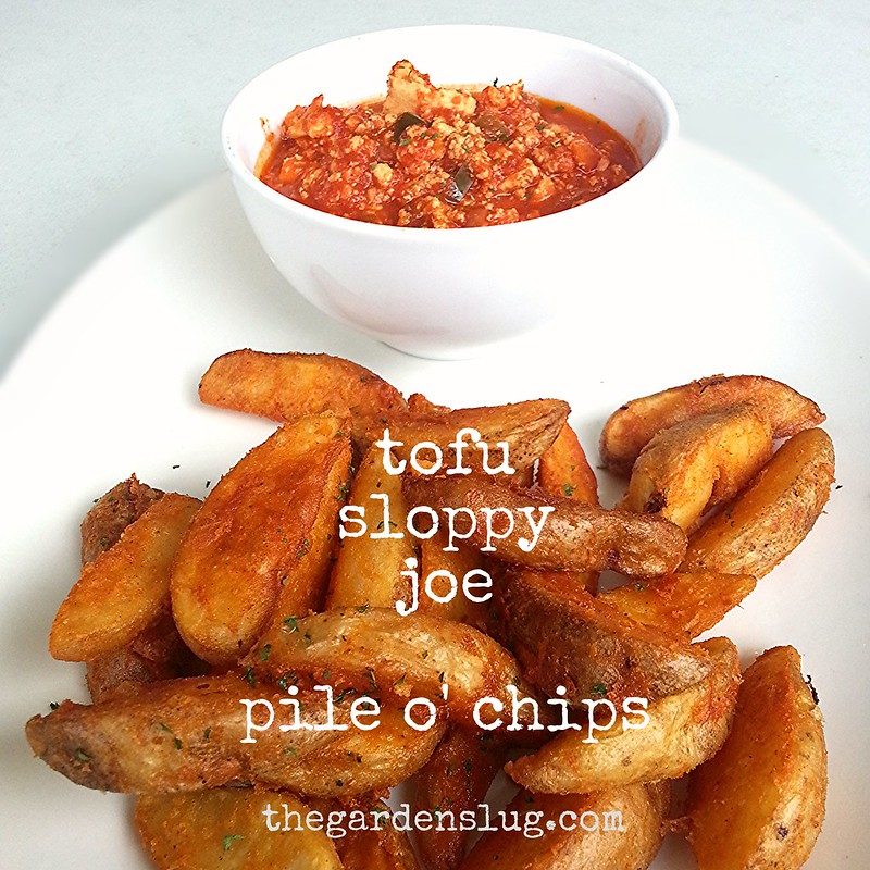 Home-style Tofu Sloppy Joe Sauce w pile of seasoned chunky potato wedges