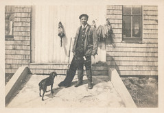 Man poses with his hunting pelts