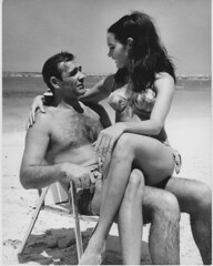 Martine_Beswick_holding_cig_with_Sean_Connery_on_set_of_Thunderball_in_1965