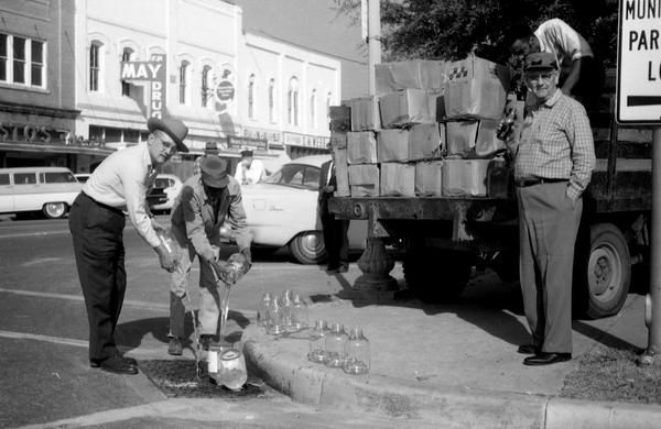Gadsden County Deputy Sheriff Robert Martin disposing of moonshine in Quincy, Florida