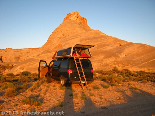"Wouldn't you rather sleep up there than on the ground? Not really; I sleep inside the van! Near the ""Graveyard of Arches"" in Utah."