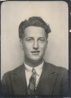 Photo booth photo of a man in a suit and tie