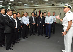 Rear Adm. Robert Girrier, deputy commander of U.S. Pacific Fleet, speaks with U.S. Defense Secretary Chuck Hagel and defense minsters from the Association of Southeast Asian Nations (ASEAN) aboard USS Anchorage (LPD 23). (U.S. Navy/MC1 Amanda Dunford)