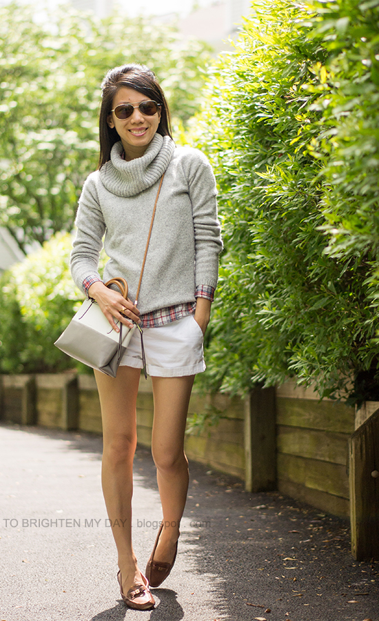 gray cowlneck sweater, plaid shirt, white shorts, brown loafers