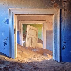 Since its abandonment in 1954, the once-booming mining town of Kolmanskop has gradually succumbed to the sands of the Namib Desert. The small town near the coast of Namibia was built in the style of a German village following the discovery of diamonds in