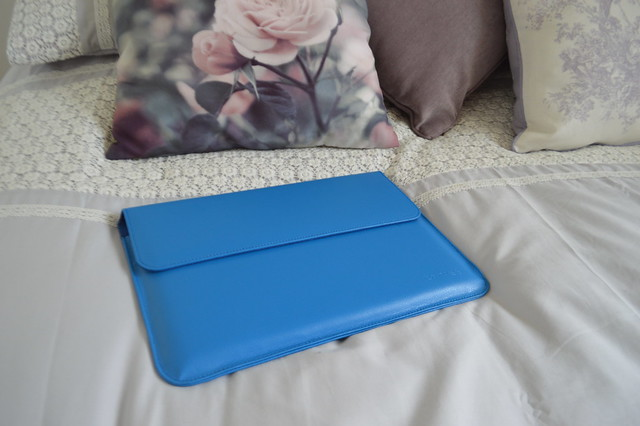 This is a picture of a blue snugg case for macbook air.