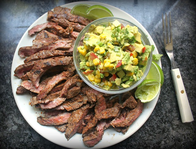 Grilled skirt steak with avocado corn salad