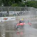 E.J. Viso navigates Turn 1 in the rain