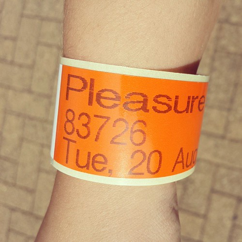 Got our wristbands. Here we go........queueing for Flying Machines. Apparently its my choice first then we're going for something scarier.....