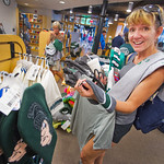 13-011 -- Joanne McKee checks out the Titan merchandise while her daughter (Cameron '17) checks in for orientation.