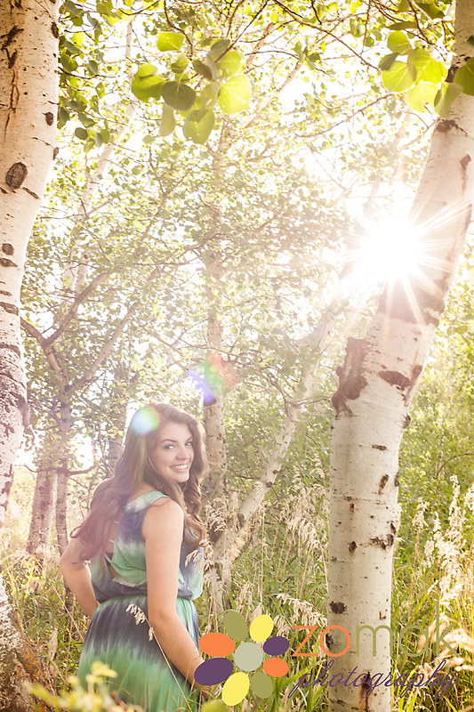 birch trees surround cassidy in this senior photo taken in helena montana
