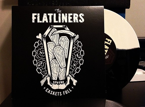 "The Flatliners - Caskets Full 7"" - Black & White Split Vinyl by Tim PopKid"
