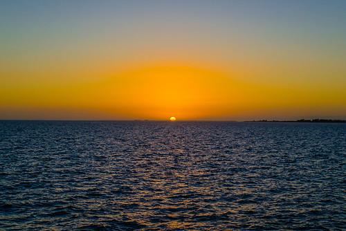 Sun resting on the horizon: North Fishing Pier at the Sunshine Skyway Bridge