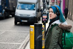 © Leanne Boulton, All Rights Reserved  Street candid taken in Glasgow, Scotland. I was drawn to the deep blue hair colour and also noticed that her headphones and the sticker on the crossing controls matched colours. It's the little things that sometimes bring the most surprising of smiles to my fac...