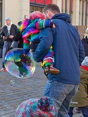 Colorful bubble meets colorful child