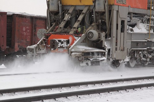 Detail of the collection head removing snow from the tracks