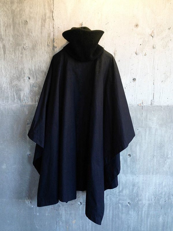 Raf Simons black wool knit:waxed cotton poncho   An iconic grail piece from his Autumn:Winter 2000-2001 collection