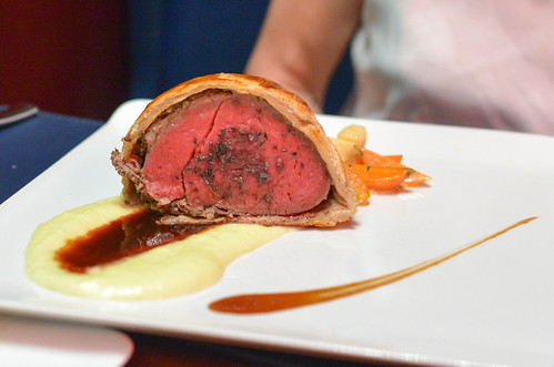 Roasted Beef Wellington glazed root vegetables, potato purée, red wine demi glace