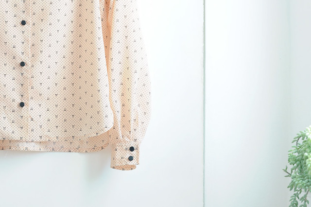peach bow blouse