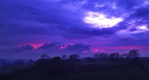 light sunset sky clouds evening view purple