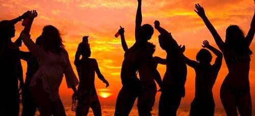 dancing people on beach