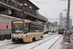 Moscow tram #2143 on route 11, passes the monorail station outside VDNH
