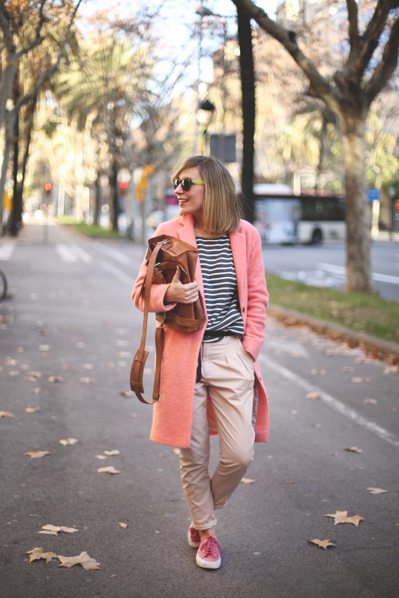 long pink coat, striped tee,pant and brown leather handbag