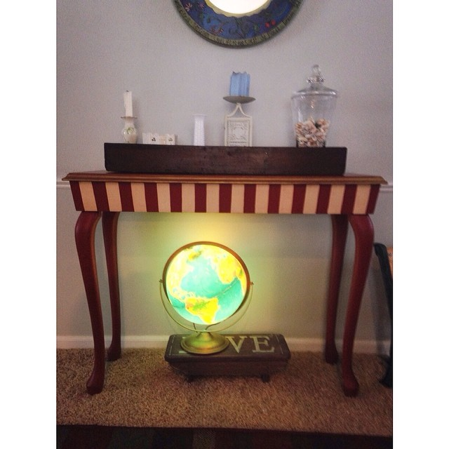 D thinks I lost it with the decorating.  I call it eclectic . #vintageglowingglobe #ineedaflowerforthevase