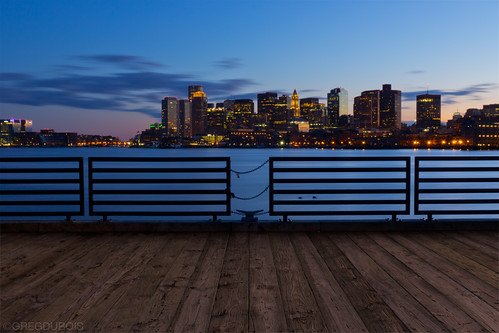 Lo Presti Park Pier and Boston Skyline over Harbor at Dusk from East Boston by Greg DuBois Photography