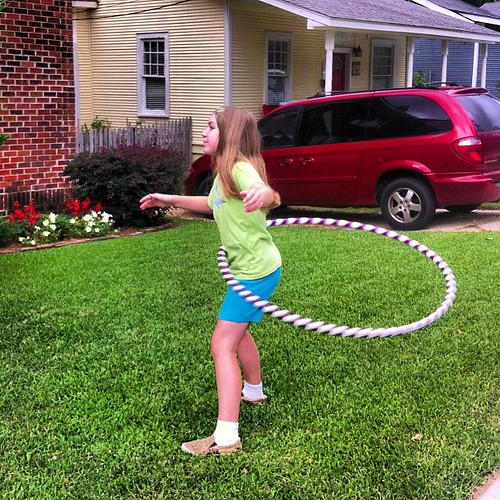 Laura practices her hula hooping skills.