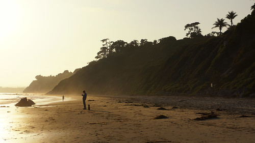 Texting the sunset away by Damian Gadal