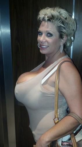 Bra busting big tits