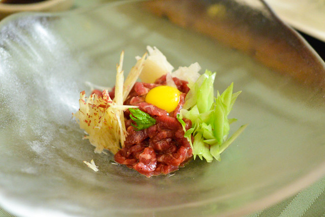 Steak tartare, japanese cucumber, pear, quail egg