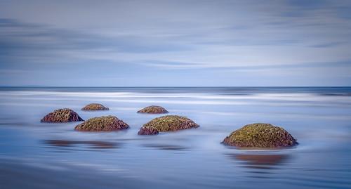 longexposure sunset newzealand beach water lines rock clouds landscape sand waves stones boulder southisland bluehour longtimeexposure moerakiboulder moerakibeach caughtinpixels jacobsurland
