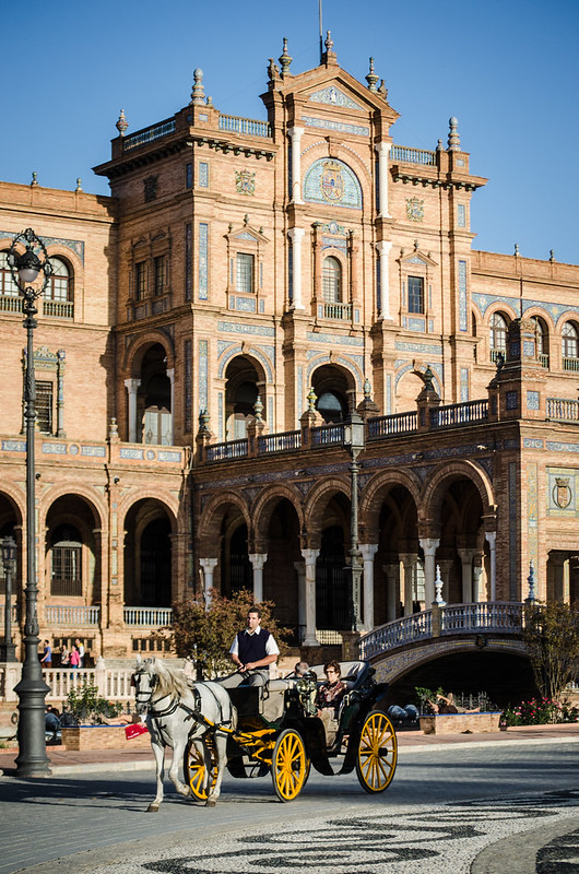 Hire a horse drawn carriage in historic Sevilla, Plaza de España is the final stop.