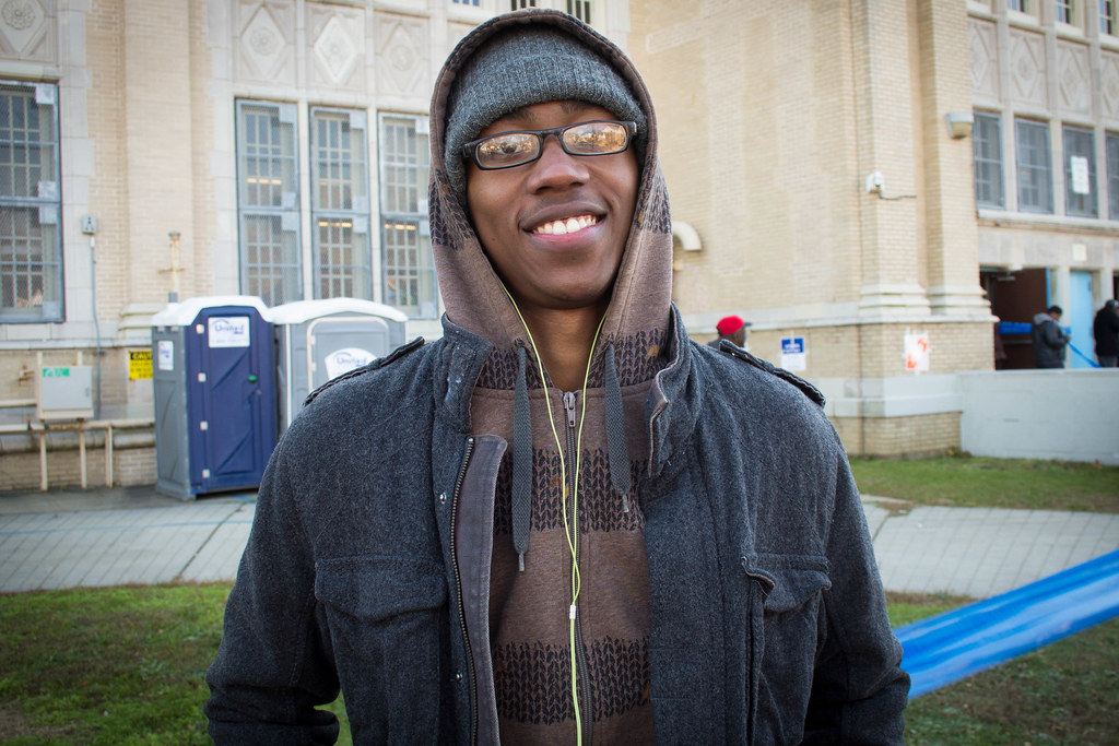 """I feel more American by voting"" -I.K., a young voter outside of Far Rockaway High School."