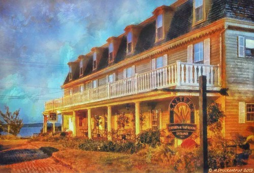 A digital painting of the Robert Morris Inn at sunrise
