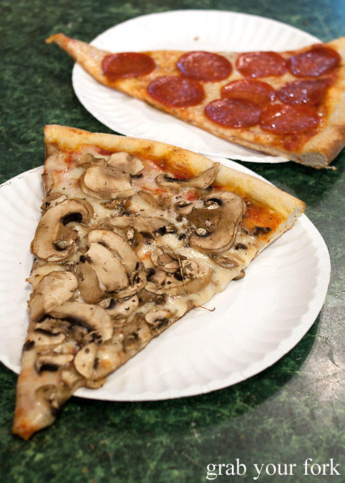 mushroom pizza slice at rosario pizza lower east side italian new york pizza ny usa