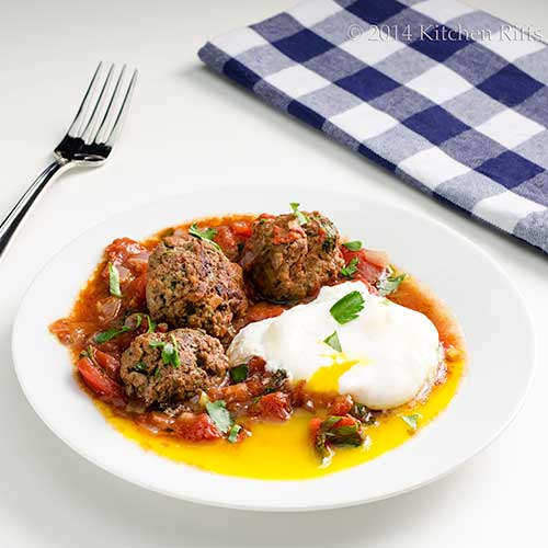 Moroccan Kefta and Tomato Tagine with poached egg garnish