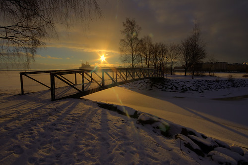 ocean bridge trees winter light shadow sea sky sun snow night sunrise finland landscape golden frozen helsinki europe flare tervasaari sunray milamai