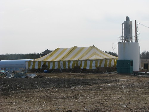 What appears to be a circus tent is anything but... rather it's a temporary cover 'protecting' damaged water treatment facility.