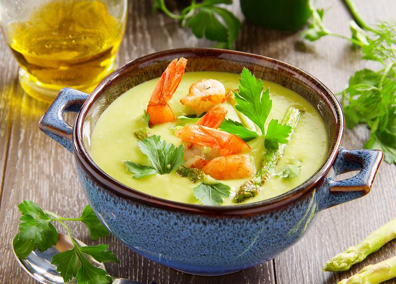 Cream of asparagus soup with shrimp.