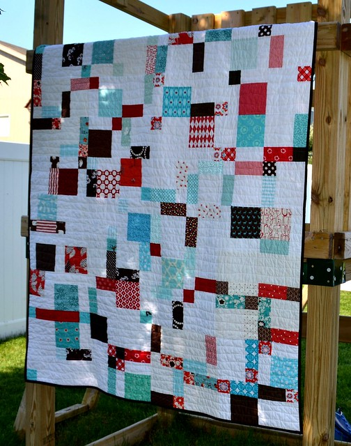 White Quilt with Boldly Patterned Pieces Throughout